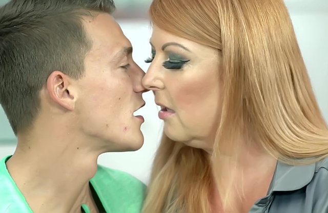 Busty redhead grandma pleasures her young grandson like a pro