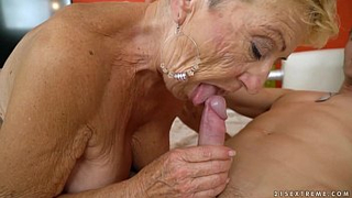 Depraved grandma giving her grandson a morning blowjob to wake him up